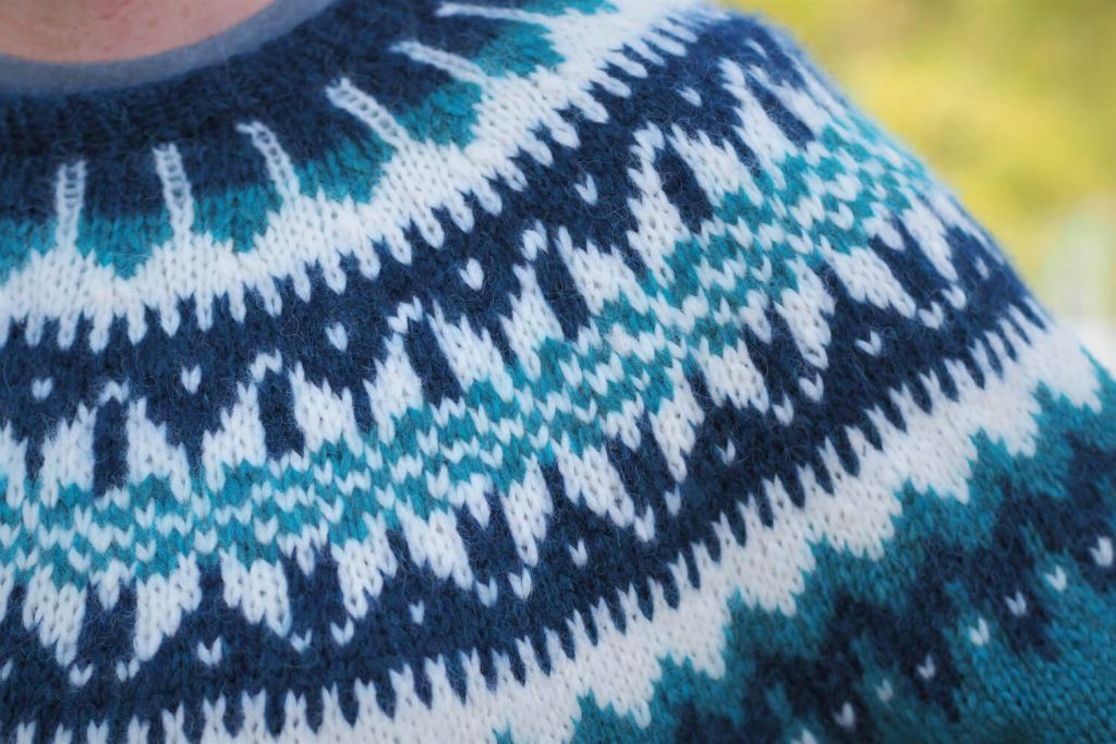 closeup of Eldfell Pullover yoke in turquoise