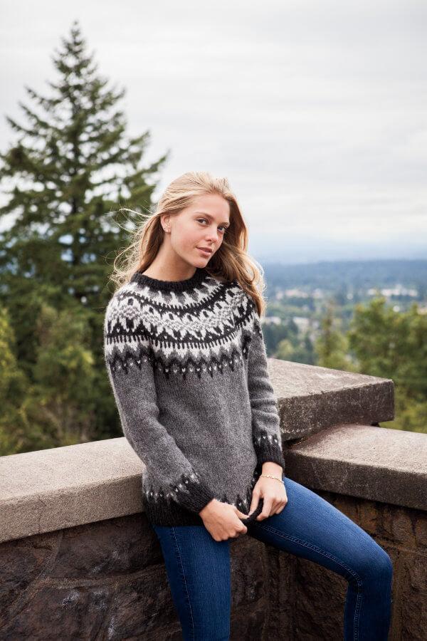 Woman outside wearing Eldfell Pullover in greys