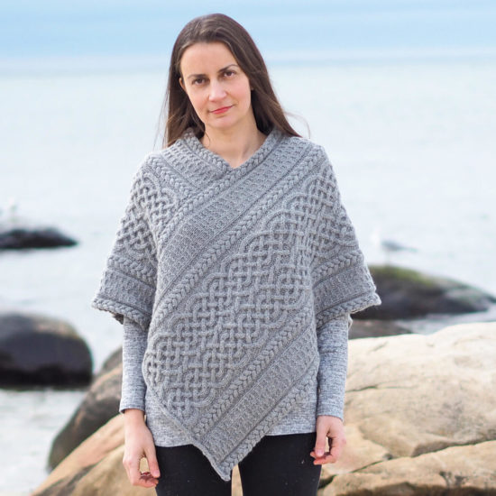 Bridget Pupillo wearing Portree Poncho outside near beach